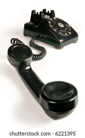 Image of an old beatup rotary telephone.  Focus is on the mouthpiece.