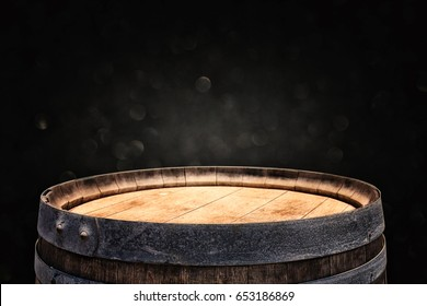 Image of old oak wine barrel in front of black background. Useful for product display montage. Vintage filtered