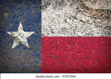 Image of an old Texas flag on the rock texture
