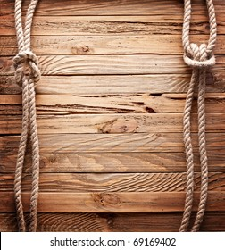 Image of old texture of wooden boards with ship rope. Wooden backgrounds.