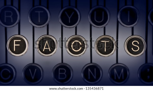 """Image of old typewriter keyboard with scratched chrome keys that spell out the word """"FACTS"""". Lighting and focus are centered on """"FACTS""""."""