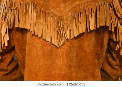 An image of an old vintage style leather coat with long fringes.