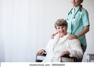 Image of old woman with walking disability