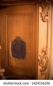 Image of a old wooden confessional in a church.