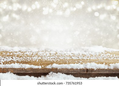 Image of old wooden table in front of glitter lights background. De-focused. Ready for product display montage