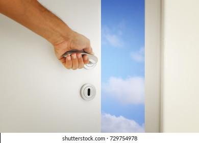 image of open door to the blue sky.