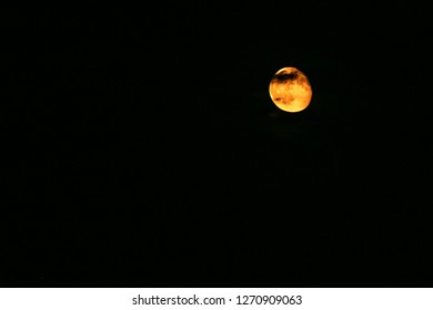 Image of the orange blod moon with negative white space