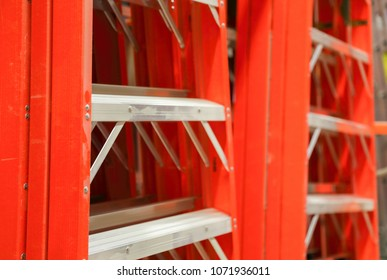 Image of orange industrial climbing ladders at a department store