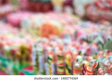Image out of focus, tasty colorful lollipops different shapes on the counter fair, beautiful background