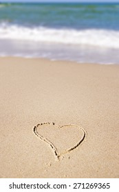 Image of a painted heart in the sand on the beach of the Baltic Sea in Germany