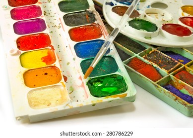 image of paints and brushes on a white background