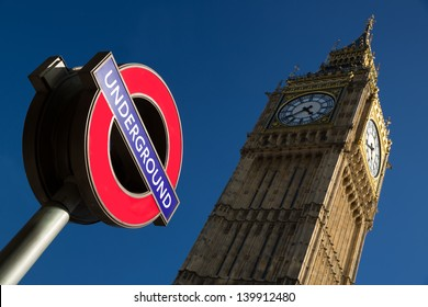 An image of the palace of Westminster with a color image of the underground sign in the foreground