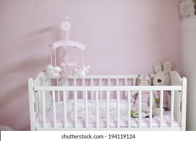 the image of parenting and baby crib
