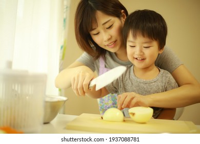 Image of parents and children cooking