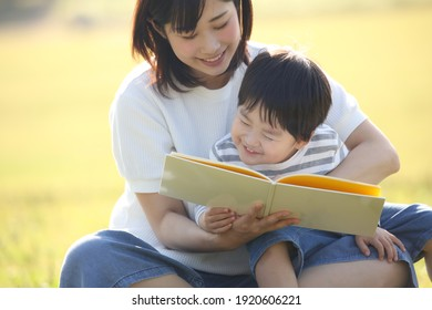 Image of parents and children reading a book