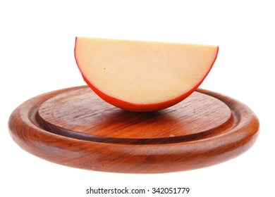 image of part of cheese on wood