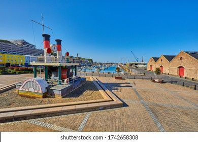 Image of Part of St Helier harbour with the steam clock in the foreground and the Old Harbour in the background. Jersey, Channel Islands, uk