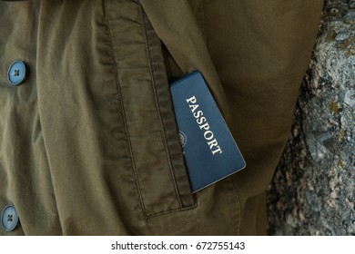 Image of a passport partly exposed in coat pocket