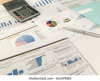 Image of pen pointing at business document during discussion at meeting of business analysis on office table with calculator and graph financial with social network diagram, vintage tone