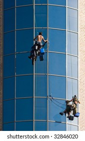 Image of people climbing up the wall of building