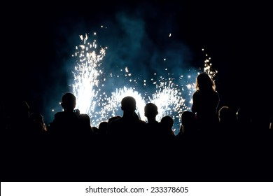 Image of a people in front of a fireworks