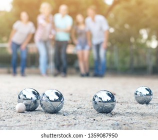 Image of people playing petanque on sand together on holidays