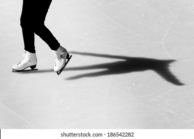 Image of people who are ice skating in the ice rink at the Medeo