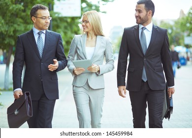 Image of a perfectly combined business team with two confident men and a lovely lady