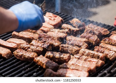 Image of a person cooking some meat.