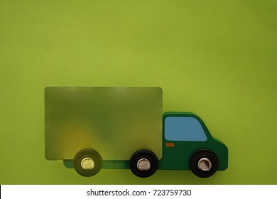 image, photo of an isolated transport truck with green credit card. large Truck on paper background. transportation background, logistic symbol. empty frame for object, inscription
