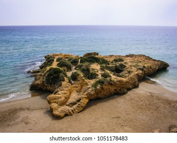 Image of picturesque stone island in bay of Tamarit in Catalunya in Spain