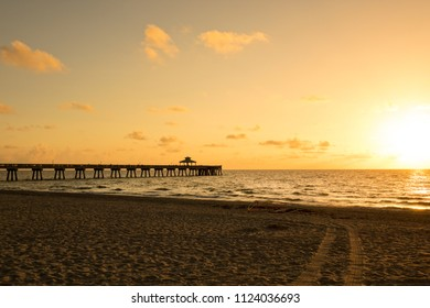 an image of pier at sunset