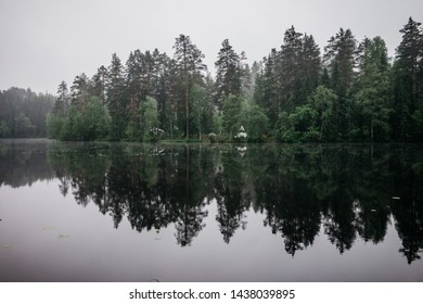image of pine forest and lake, mirror effect. Early morning on the nature, fog, white nights, Russia. place for camping, camping. Beautiful nature in eastern europe, image for background