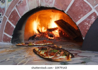 an image of Pizza fresh out of a wood burning oven