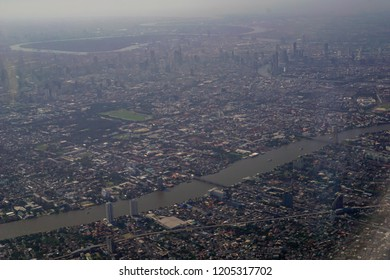 Image of plane window View of the village from the bird's eye view, Bangkok City, Thailand