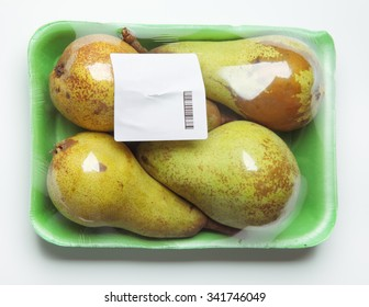Image of plastic pack of pears from store on white background