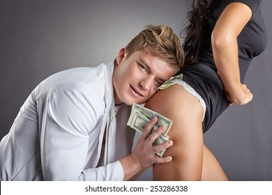 Image of pleased man hugging sexy stripper