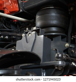 Image of a pneumatic suspension of a modern tractor.