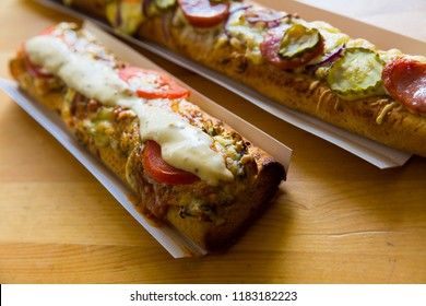 Image of polish zapiekanka toasted baguette with cheese and vegetables