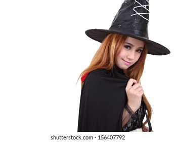 Image of portrait asian woman in black hat and black clothing on halloween