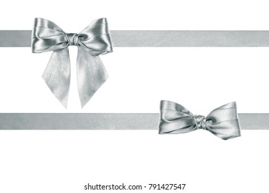 An image of a present satin silver ribbon two bows with ribbons by frame  isolated on white background