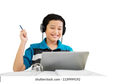 Image of preteen student hears music on a headset while studying with a laptop in the studio, isolated on white background
