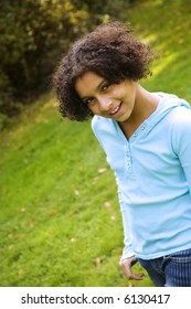 image of a pretty biracial girl in apark setting
