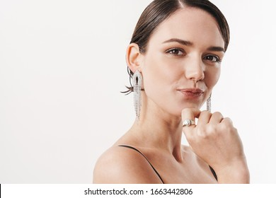 Image of pretty brunette young woman wearing dress smiling at camera isolated over white background