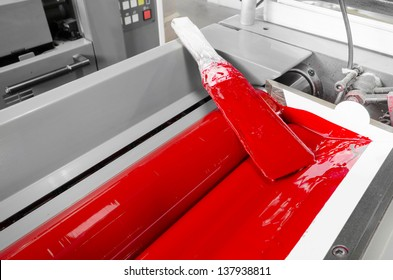 Image of processed ink in the fountains and on the rollers of a four color printing press
