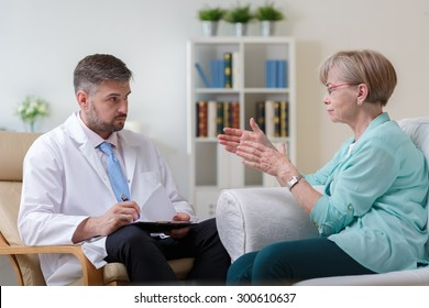 Image of psychiatrist listening to his female patient with depression