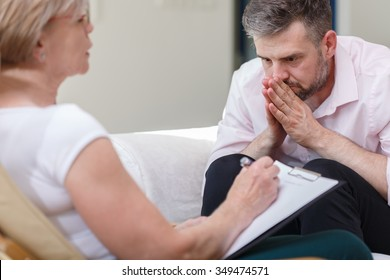 Image of psychiatrist supporting her patient with mental problem