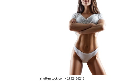 Image of a pumped up abs. Beautiful sportive woman posing in studio on a white background. Fitness, bodybuilding, aerobics concept. Mixed media