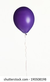 An image of a purple helium party balloon