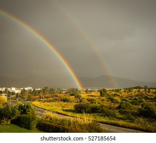 Image of a rainbow over the suburb of Athens, Greece